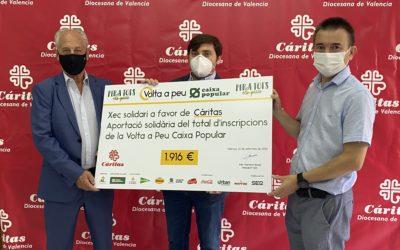 Volta a Peu València Caixa Popular dona 1.916€ a Cáritas gracias a la solidaridad de los participantes de la carrera popular